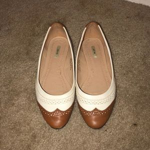 Tan and beige flats